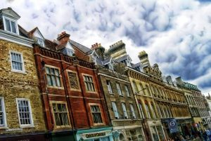 row of houses above a shop on busy high street